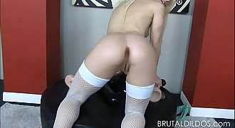 Petite blonde brutalizes both her slots with big dildos